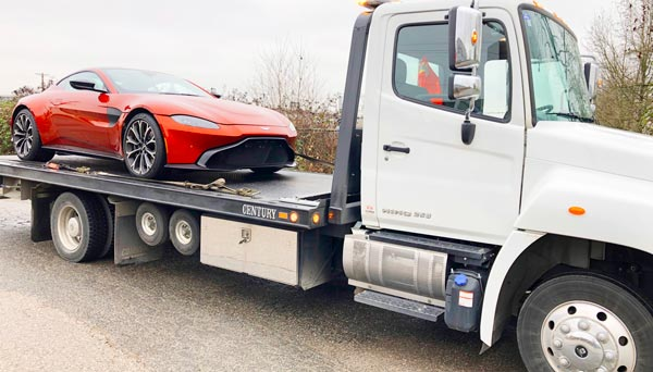 sports car on flat bed tow truck